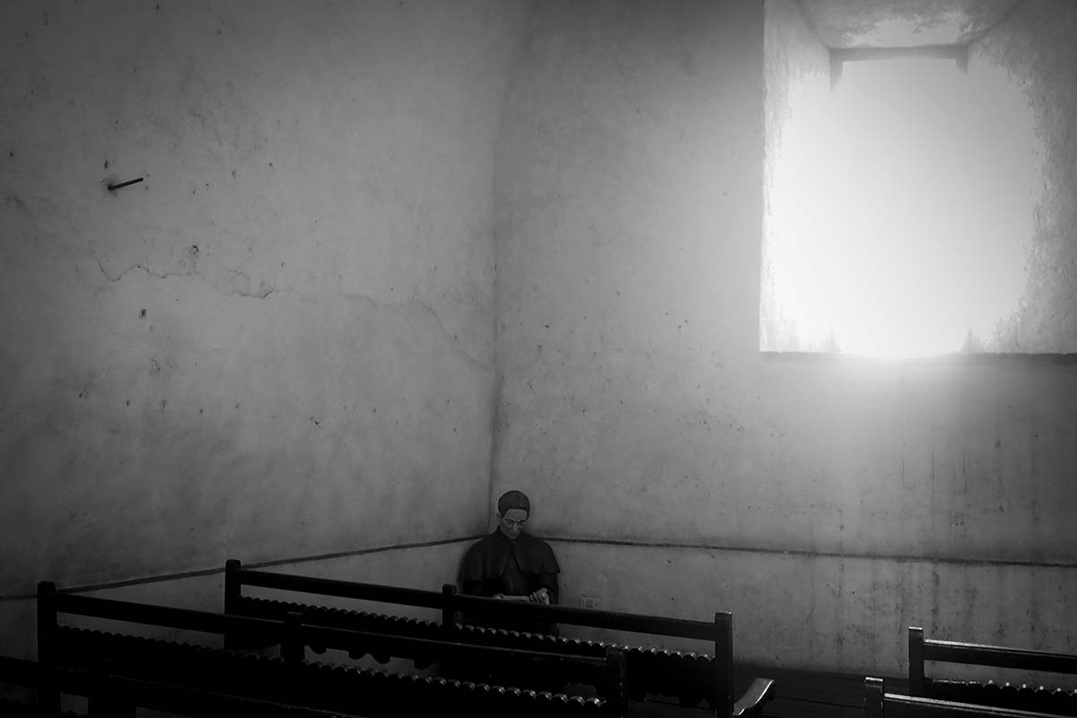 cuban picture of one priest in the shadows - Anonymous Island - Anonymous Island - Cuban Photo essay of Louis Alarcon about Cuba and its mistery