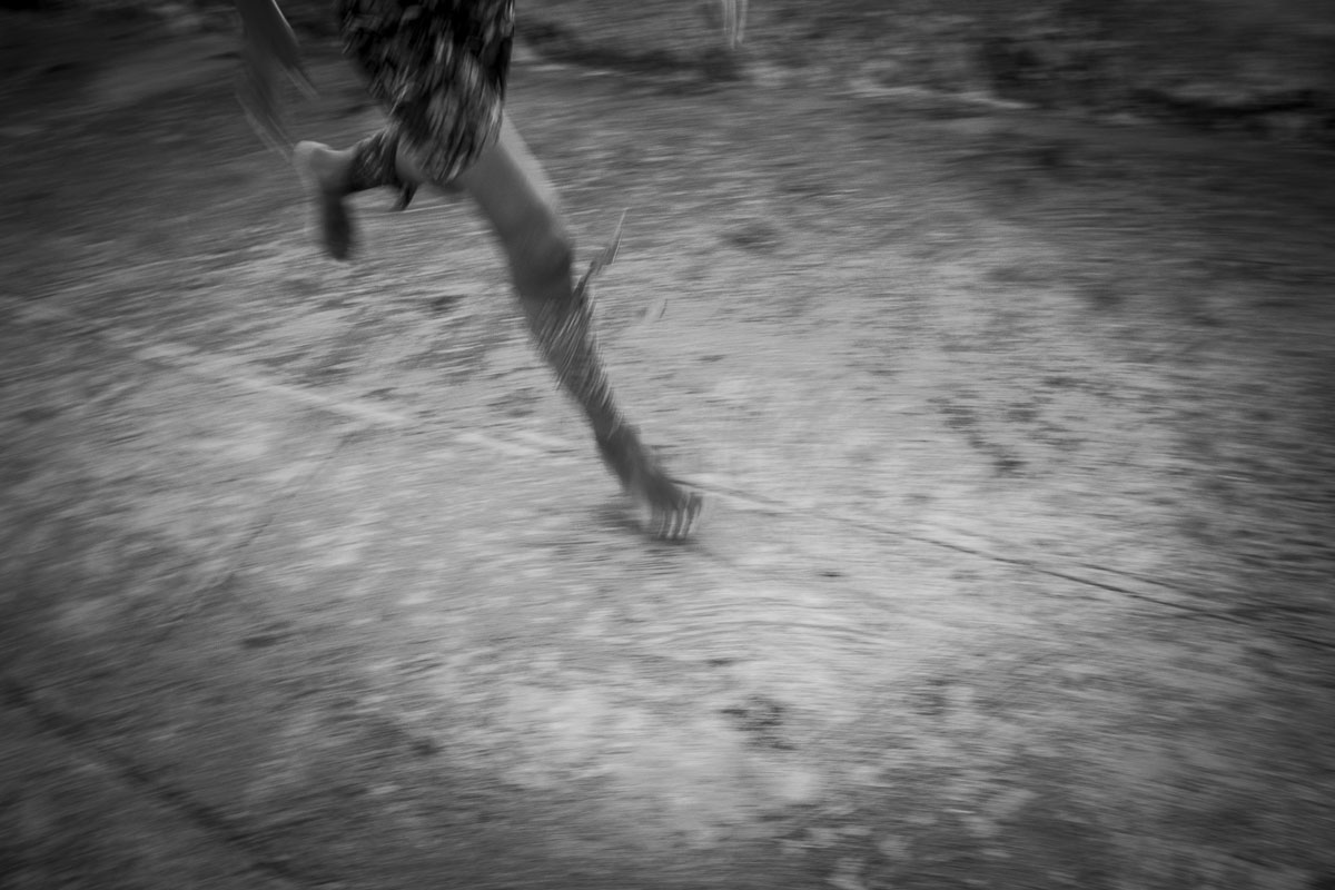 legs of a cuban boy running. Picture in havana - Jumpers - Last jump in Havana - Cuban Photography essay about the last jumpers in Malecon.